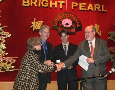 Co-directors Ruth Sandwell, Peter Gossage and John Lutz receive Pierre Berton Prize from his son, Peter Berton.